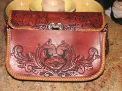 front of purse under the flap