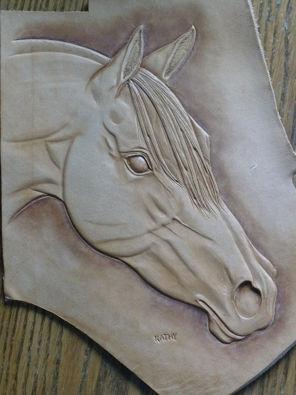 Carving horses figure leatherworker