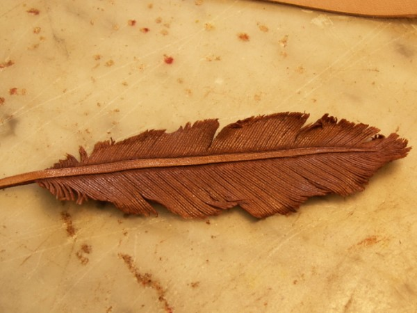 Leather feathers figure carving leatherworker