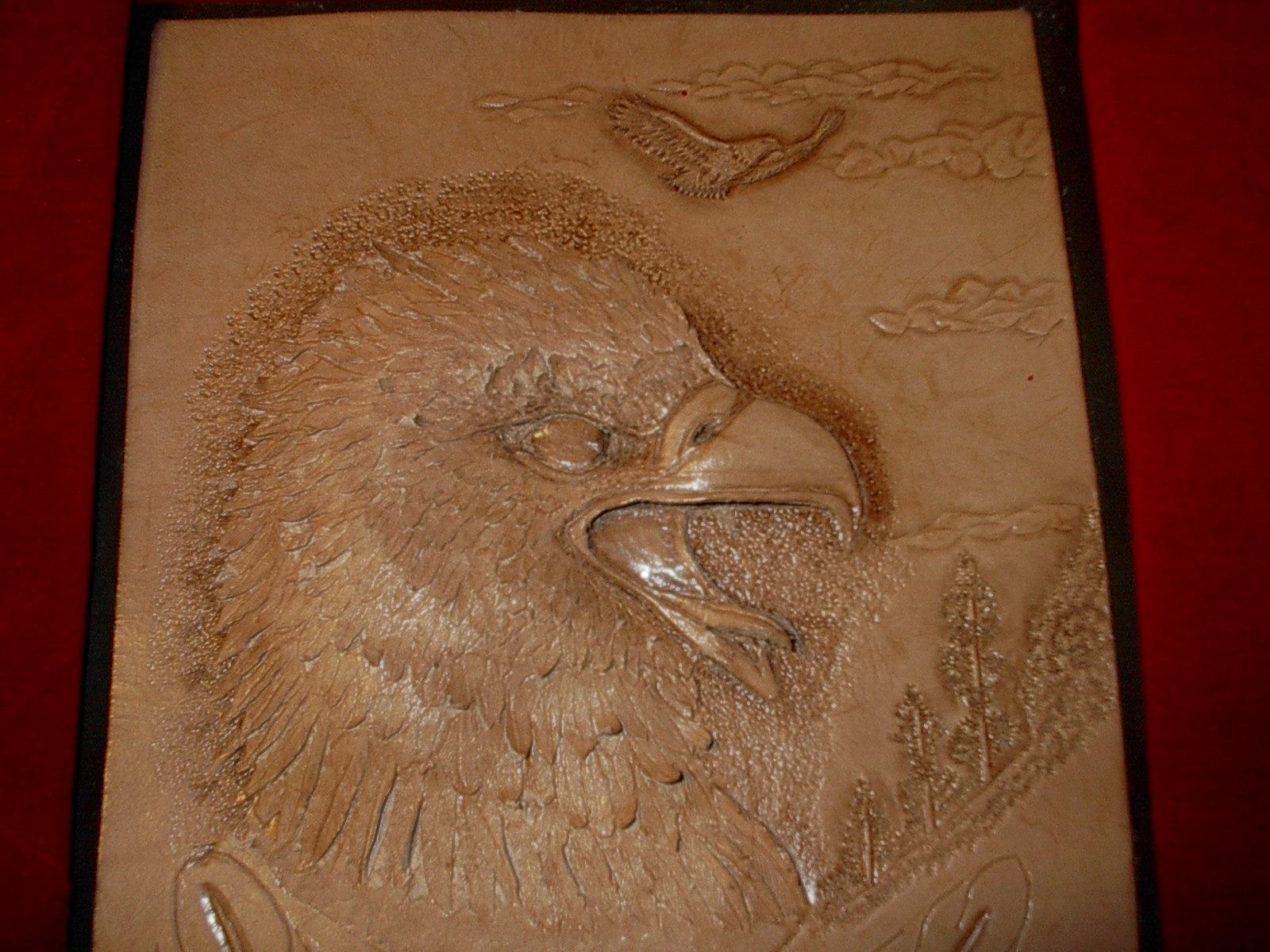 Embossed eagles head figure carving leatherworker