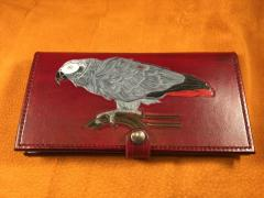 """This is a hand painted wallet I have named """"Willard"""" in honor of the bird.  Far from perfect but they were happy."""