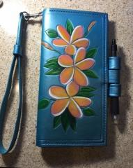 Plumeria Passport Wallet.  First wristlet (I had to google what that was at the time of order)