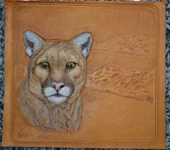 Mountain lion (puma). Carving & embossing.