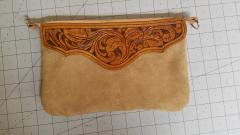 Suede wristlet with floral tooling