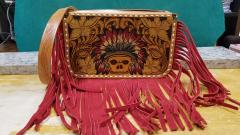 Fringed tooled leather bag