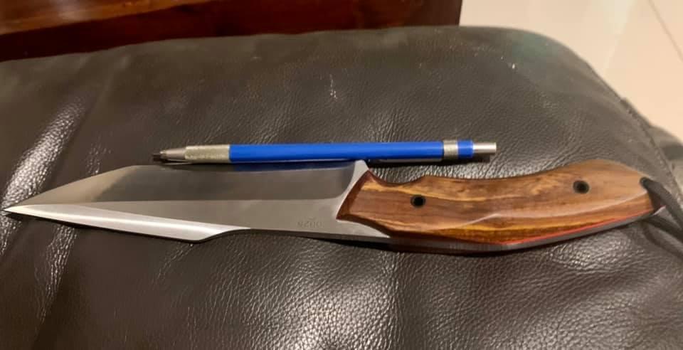 Knife to sheath.jpg